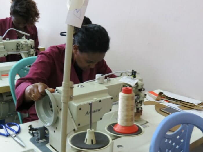 Trainees Practicing Cutting and Sewing