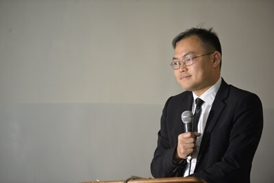 Mr. Hu, from CGCOC delivering his remarks