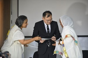 Mr. Hu Yang Jun ,  with  w/ro  Nigest Haile, Executive Director of CAWEE  Giving certificates to the graduates