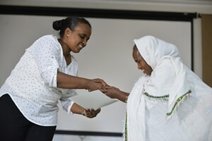 Dr. Yetemwork, right, Handing-over Certificates to Trainees