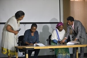 Mrs. Bethlehem Owner & Manager of Entoto Bete Artisan (sitting left) and the Leaders of the Two Women   Groups (sitting right) officially Signing the Agreement and hand-over document