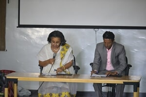 Mrs. Nigest, left and Mr. Beyene right, during the signing of the project hand-over document
