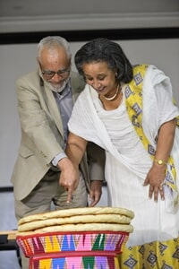 Dr. Tsehaye Teferra, Axsum Heritage Foundation Funder (Left) and W/ro Nigest (left) cutting breads