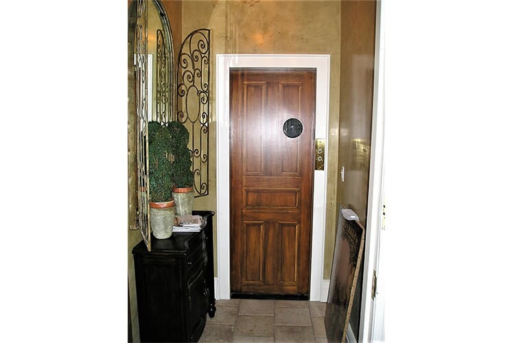 Faux wood graining on elevator door