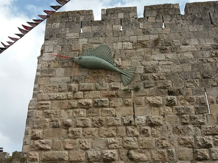 Sculpting a huge fiberglass fish with an internal lighting system for a festival in the Old City of Jerusalem A