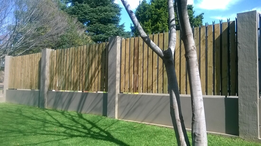Palisade Fencing with Wooden Inserts