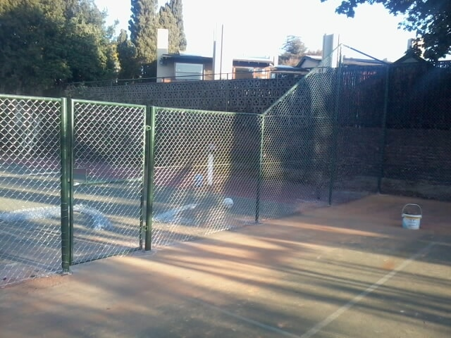 Tennis Court Framework And Diamond Mesh Fencing